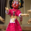 Red puppet on a string in Kathmandu — Stock Photo