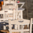 Stock Photo: Close-up from white chair and white table.