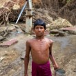 Young boy carrying water at the water pump in India — Stock Photo #30043743