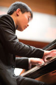 Pianist playing in a classical music concert at the Shanghai Con — Stock Photo