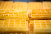 Close up of a yellow waffles with selective focus. — Stock Photo