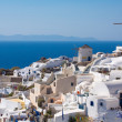 the windmill in oia and the aegean sea in greece — Stock Photo