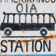 Sign of a bus at the bus station in Oia — Stock Photo