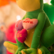 Lovely green frog with love-harts in toy-store in Bourges — Stock Photo
