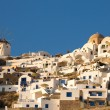 Windmill and different hotels at Oia — Stock Photo