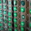 Stock Photo: Green repeated numbers on wall
