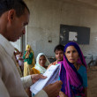 Постер, плакат: Patrients queuing to have a free medical consultation in India