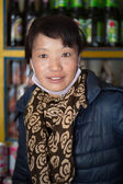 Chinese woman posing in her shop — Stock Photo
