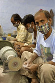 Masked artisans working for Tara, a Fair Trade Organization base — Foto Stock