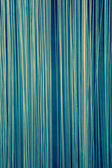 Blue abstract background made of vertical lines — Stock Photo