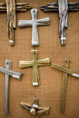 Christian religious crosses hanging on the canvas wal — Stock Photo
