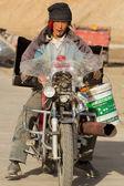 Tibetan worker driving a broken local Chinese motorbike in Tibet — Stock Photo