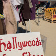 Stock Photo: Sign board with hollywood free store written on it with old clot