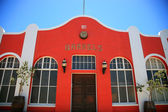 Red house traditional house with a blue sky in Luderitz — Stock Photo