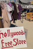 Sign board with hollywood free store written on it with old clot — Stock Photo