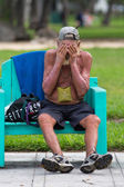 Unrecognizable homeless in Miami Beach sitting on a bench — Stock Photo