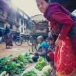 Nepalese women working on a fruits and vegetables market in nepa — Stock Photo