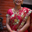 Woman dressed in a red traditional indian dress for a wedding in — Foto de Stock