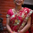 Woman dressed in a red traditional indian dress for a wedding in — Stock fotografie