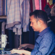 Stock Photo: Tailor working in his tiny shop in Nepal