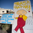 Stock Photo: Steward GilligGriffin drawing pointing trash areoutside o