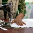 Unregnizable craftsman sewing several pieces of clothes in India — Stock Photo
