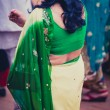 Stock Photo: Womdressed in green traditional indidress for wedding
