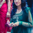 Woman dressed in a blue traditional indian dress for a wedding i — Foto de Stock