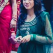 Woman dressed in a blue traditional indian dress for a wedding i — Стоковая фотография