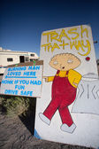Steward Gilligan Griffin drawing pointing a trash area outside o — Stock Photo