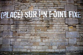 Placed on a fixed point message on a wall in Paris — Stock Photo