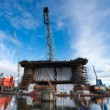 Docking oil rig at the Gdansk Shipyard under construction with f — Stock Photo