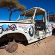 Rusted off road vehicle abandonned in the desert of Morocco — Stockfoto