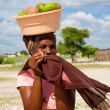 Stock Photo: African woman carrying fruits on her head in Botswana