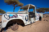 Rusted off road vehicle abandonned in the desert of Morocco — Stock Photo