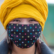 Portrait of a Tibetan woman wearing a mask — Stock Photo