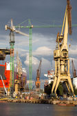 Huge ships in a dry dock with cranes, Gdansk — Stock Photo