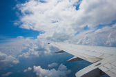 Airplane wing and clouds — Stockfoto