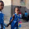 African girls dressed in blue on the way to school in Senegal — Stock Photo #35793251