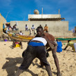 Постер, плакат: Group of wrestlers training on the beach in Senegal
