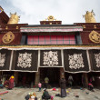 Stock Photo: Group of Tibetpeople praying at Jokhang Temple in Lhasa