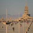 People cycling towards the Temple at Burning Man — Stock Photo