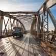 Public bus crossing the Faidherbe Bridge in Saint Louis — Stock Photo