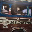 People traveling into an old bus local bus in Senegal — Stock Photo #35796909