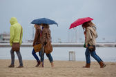 Women walking on the beach in Sopot — Stock Photo