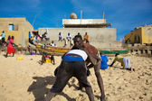 Group of wrestlers training on the beach in Senegal — Stock Photo
