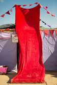 Red fabric covering the entrance of a tent — Stock Photo