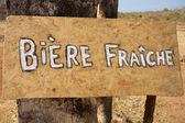 Sign board with Fresh Beer in French — Stock Photo