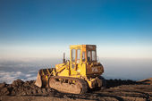 Yellow tractor at the top of the Etna mountain with view on the — Stock Photo