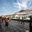 Tibetan prayers praying around the Potala Palace in Lhasa, Tibet — Stock Photo